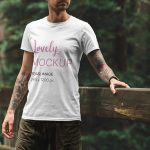 T-Shirt Mockup of a Man Standing on a Bridge Featured
