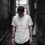T-Shirt Mockup of a Cool Man Posing in a Dark Alley Featured