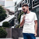 T-Shirt Mockup Featuring a Stylish Man in the City Featured