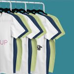 Mockup of T-Shirts Hanging from a Clothing Rack Featured