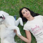 T-Shirt Mockup of a Woman Lying on the Grass Featured