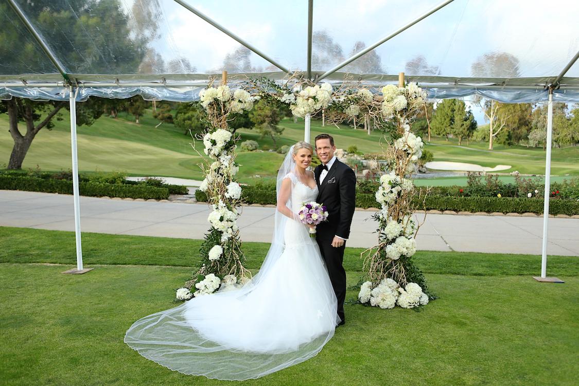 real_weddings_kristen_flower_wall