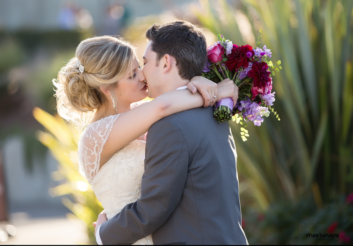 wedding budget tips, bride and groom, first kiss