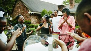 family playing bang clap snap game