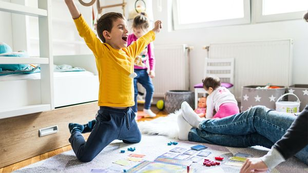 boy playing board game learn vocabulary