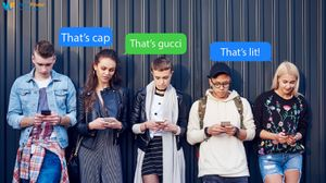 group of teenagers texting on phones