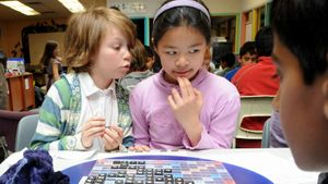 children playing in school scrabble tournament