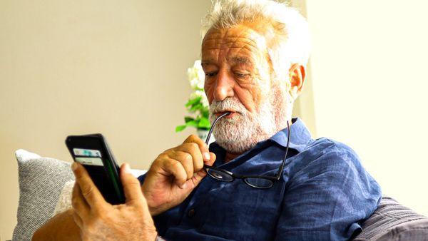 man playing brain game on phone