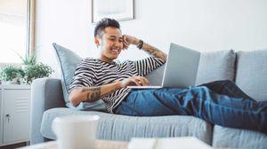 man playing online trivia game