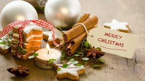 merry christmas words with cookies and ornaments