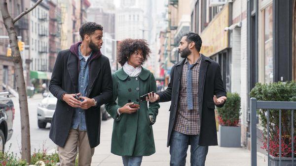 friends talking on street in New York City