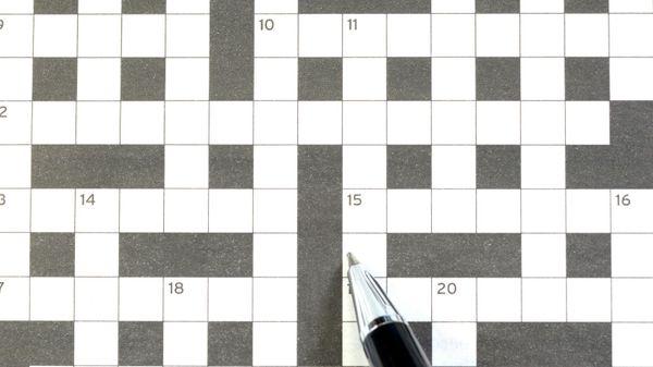 Empty crossword puzzle with pen