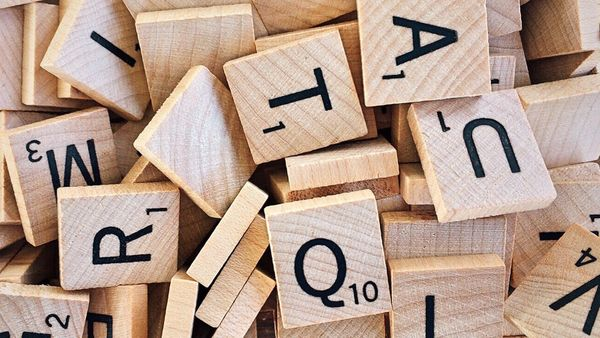Scrabble tiles - Q without U words