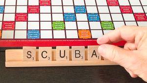 Scrabble letters spelling the acronym SCUBA