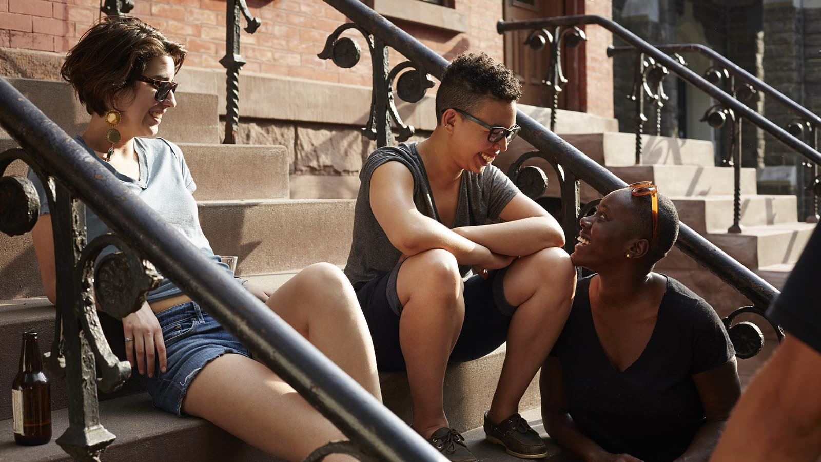 friends on stoop in New York city