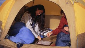 play travel scrabble game in tent