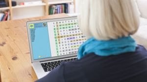 woman playing free word search game on laptop