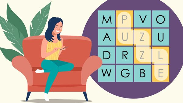 woman on sofa playing word search game