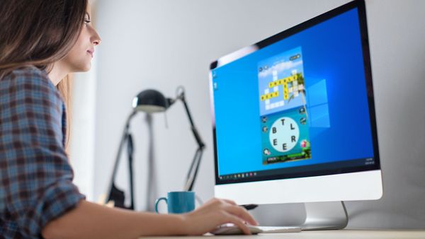 Woman playing Wordscapes on computer