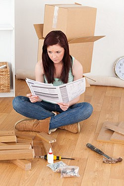 Woman reading directions putting furniture together as technical writing examples