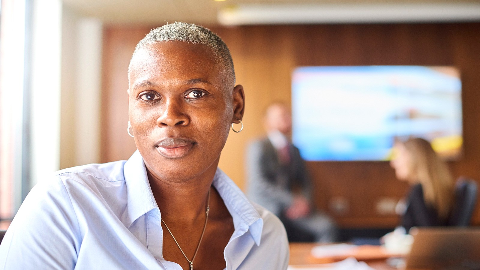 confident business woman in boardroom