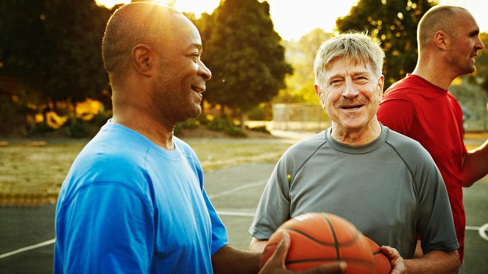 group of senior men playing basketball