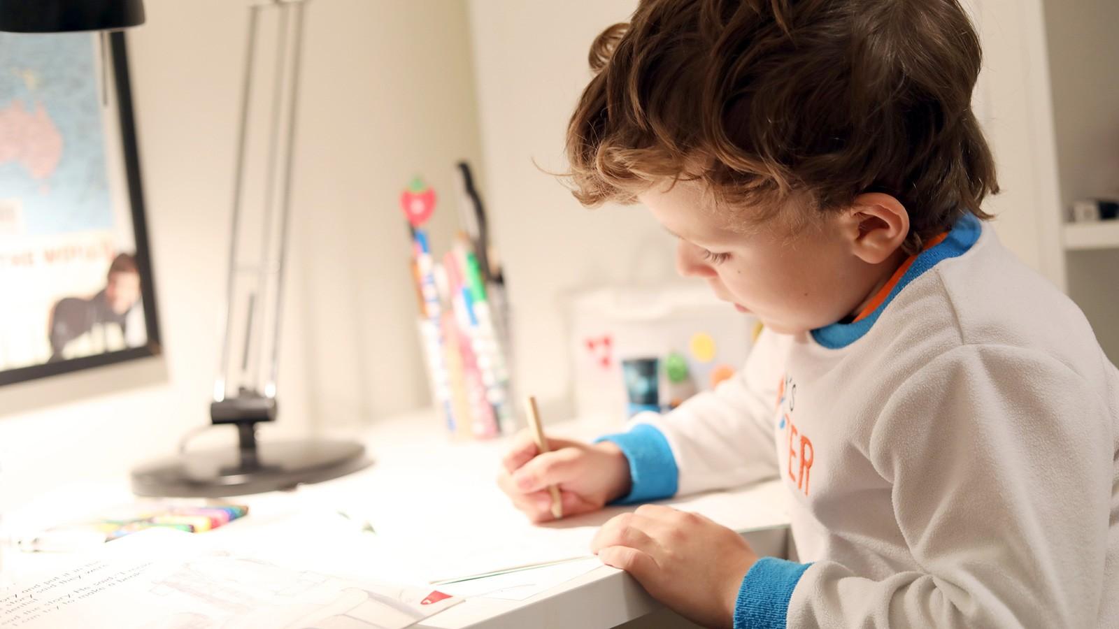 Kindergartener working on worksheet