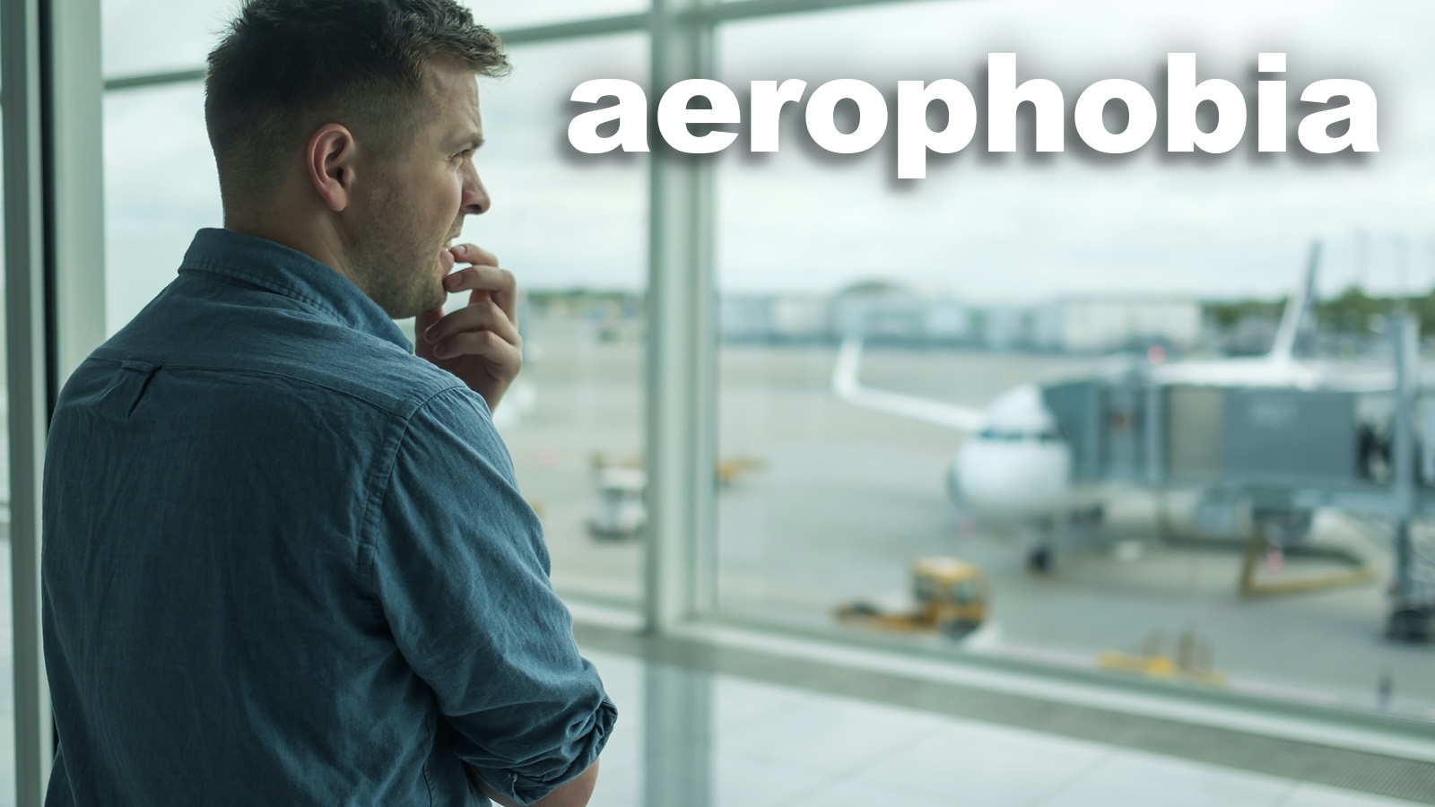 Man at airport with phobia of flying aerophobia