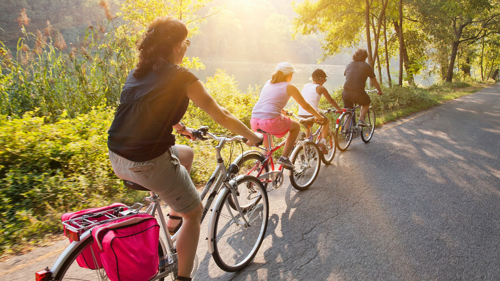 people riding bikes on country road