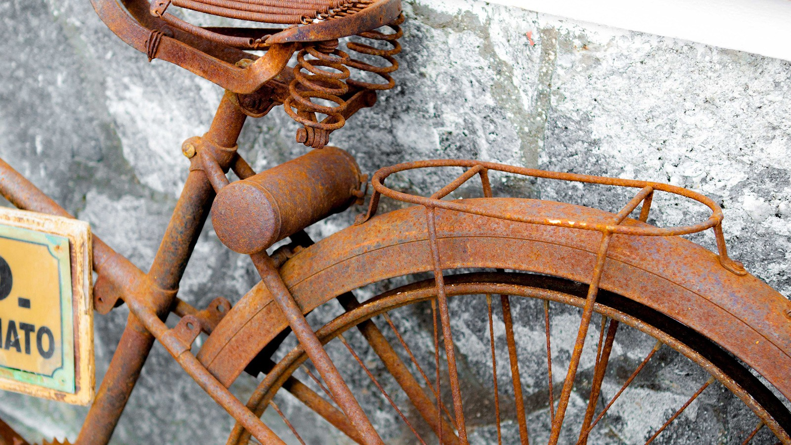 rusted bicycle sitting outside