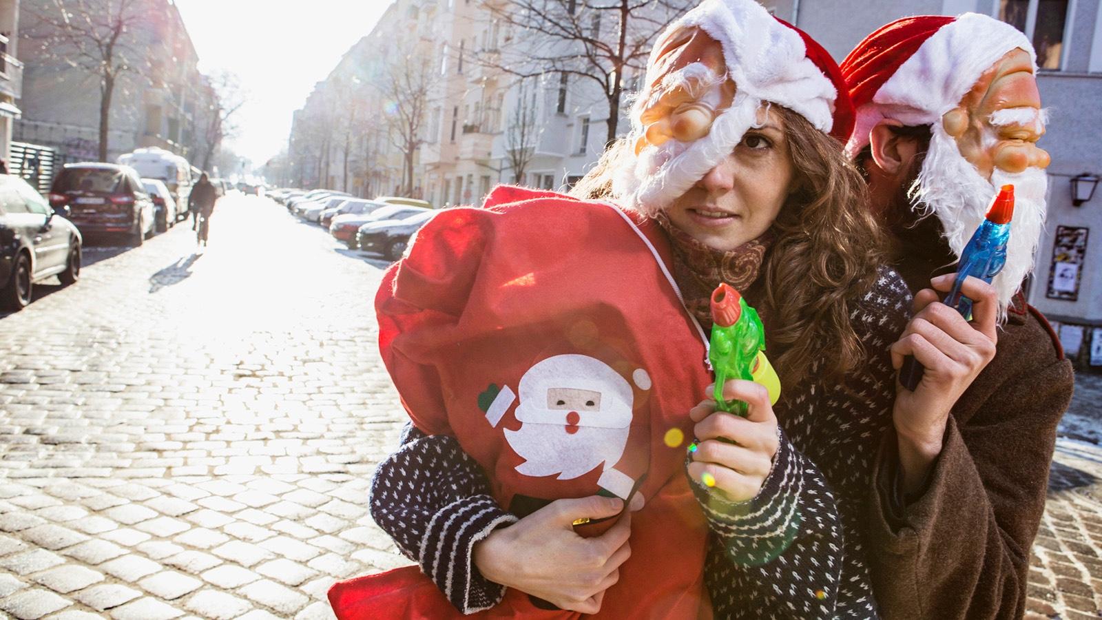 Comedy satire Santa robbers on street