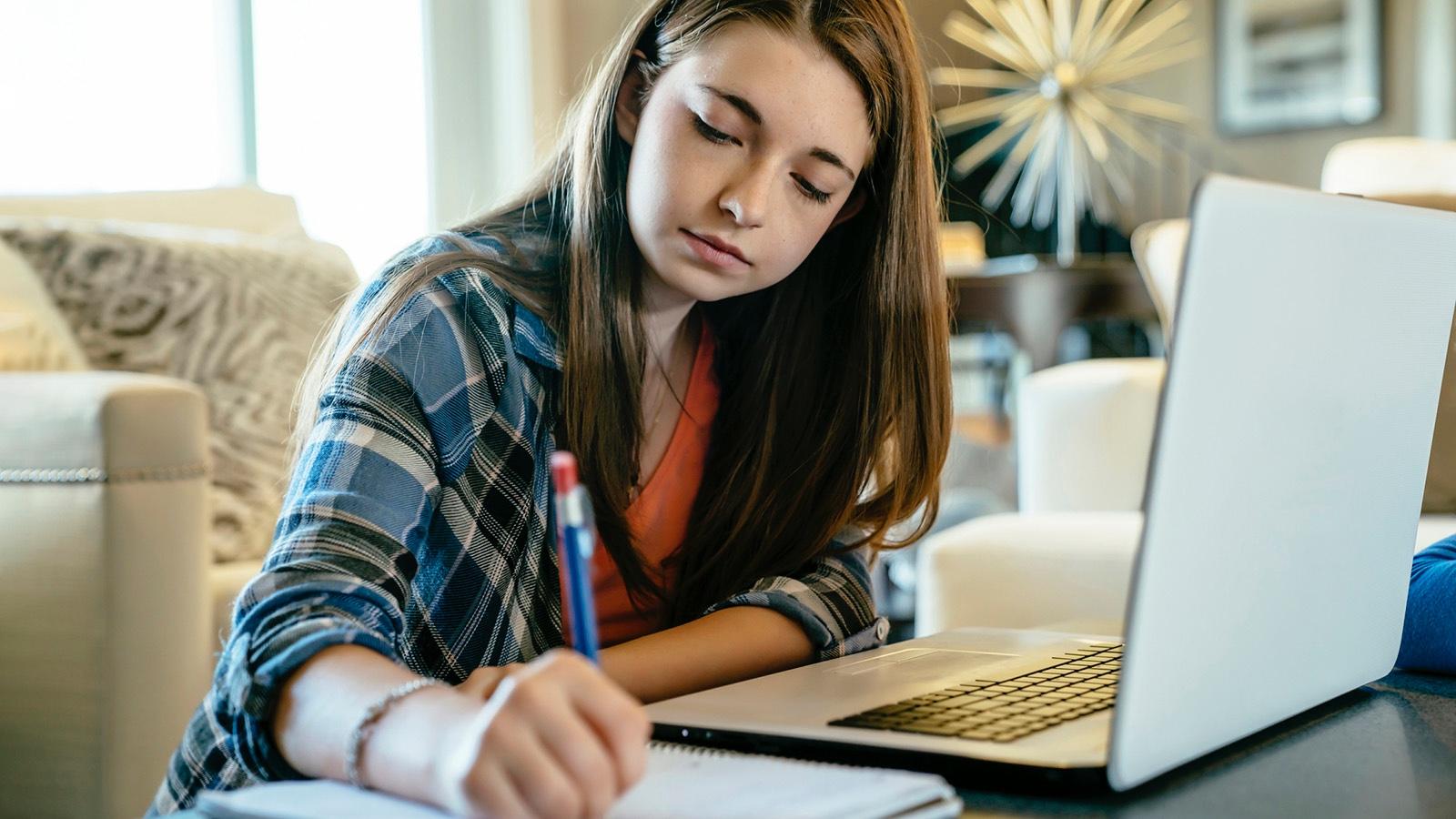 teenage girl writing figurative language