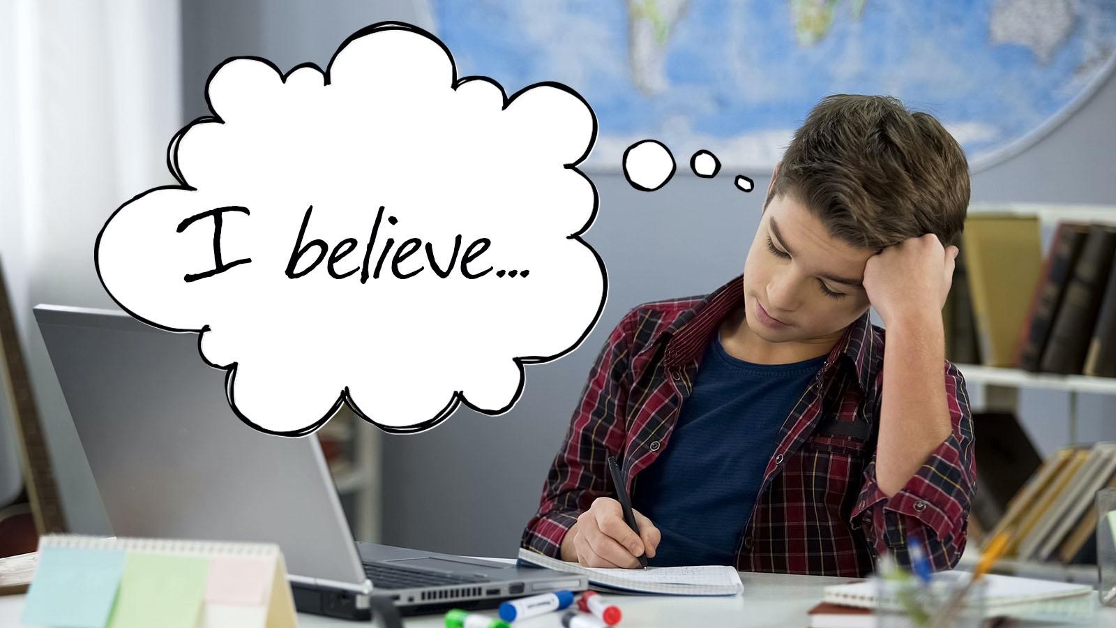 Teenage boy writing an opinion essay
