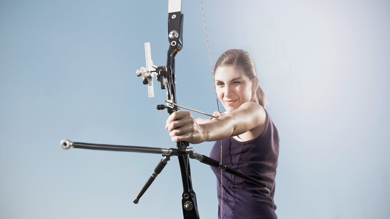 woman archer aiming a bow