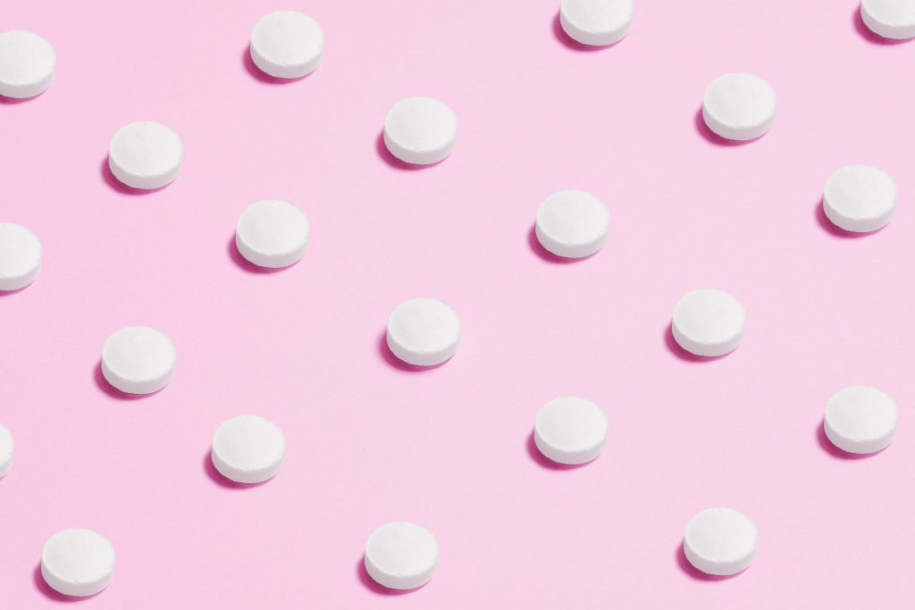 039a9f08-white-round-capsule-on-pink-background-close-up-photography-3683047-min-scaled.jpg