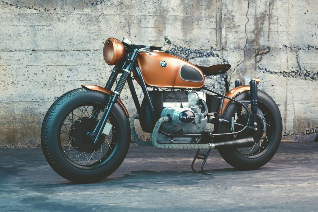 4d3770b5-orange-and-black-bmw-motorcycle-before-concrete-wall-104842-min-scaled.jpg