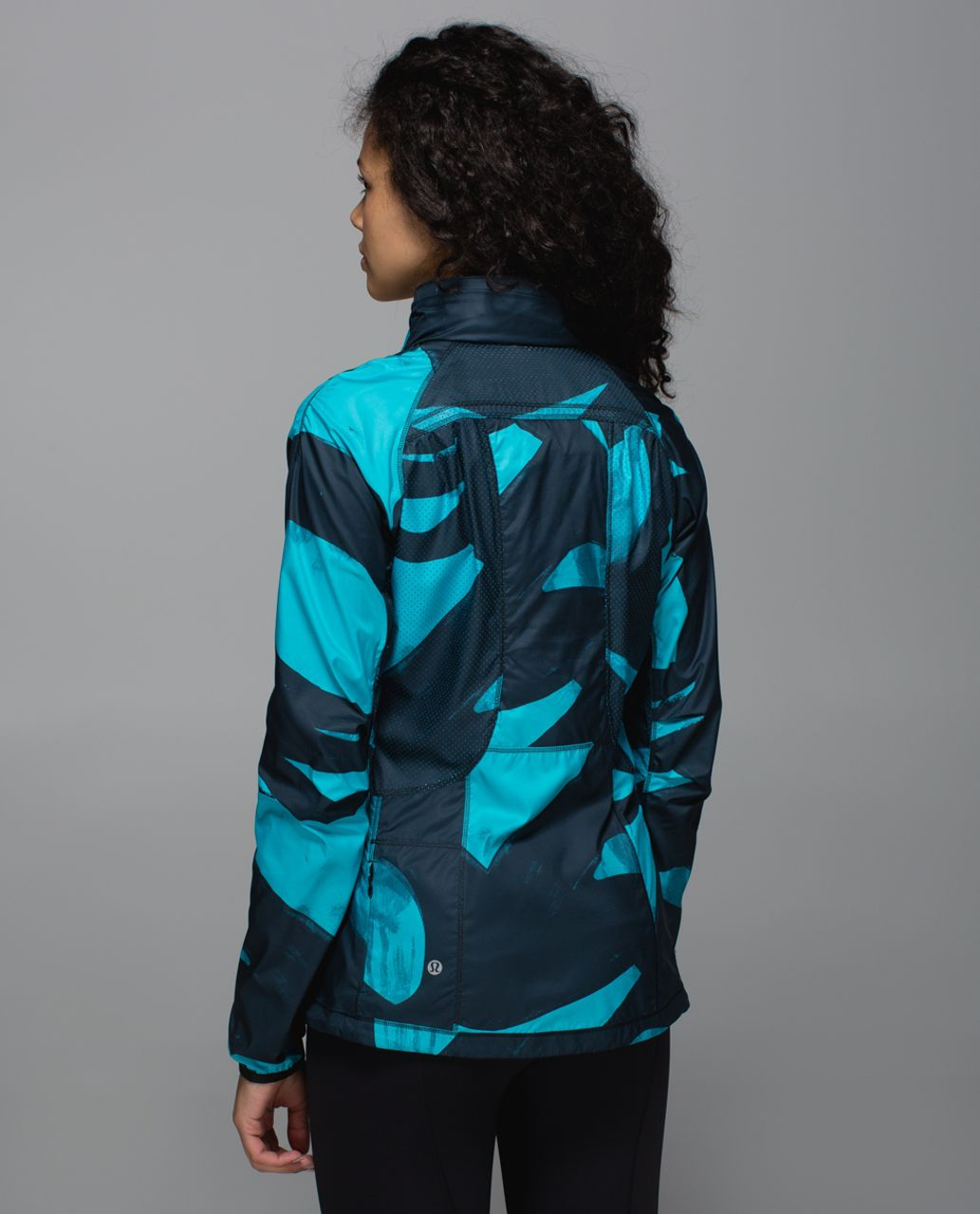 TEAL /& ROYAL PEACOCKS on a black  jacket