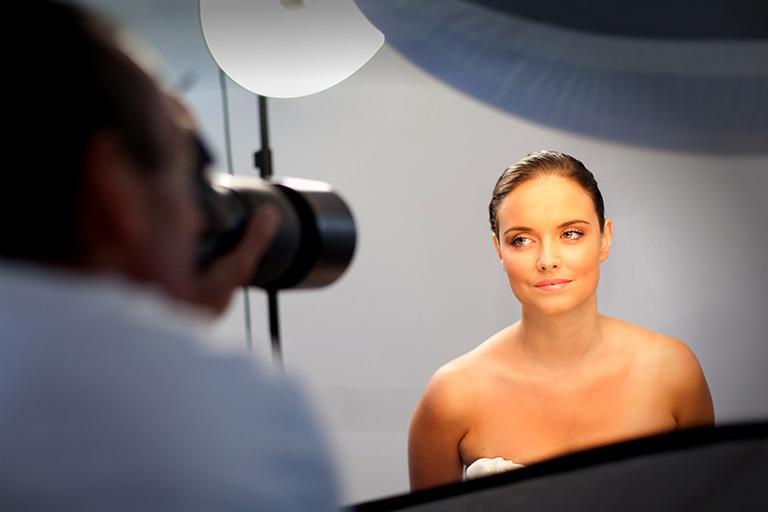 women getting photograph taken in studio