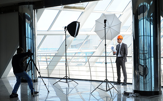 photographer taking picture of business man