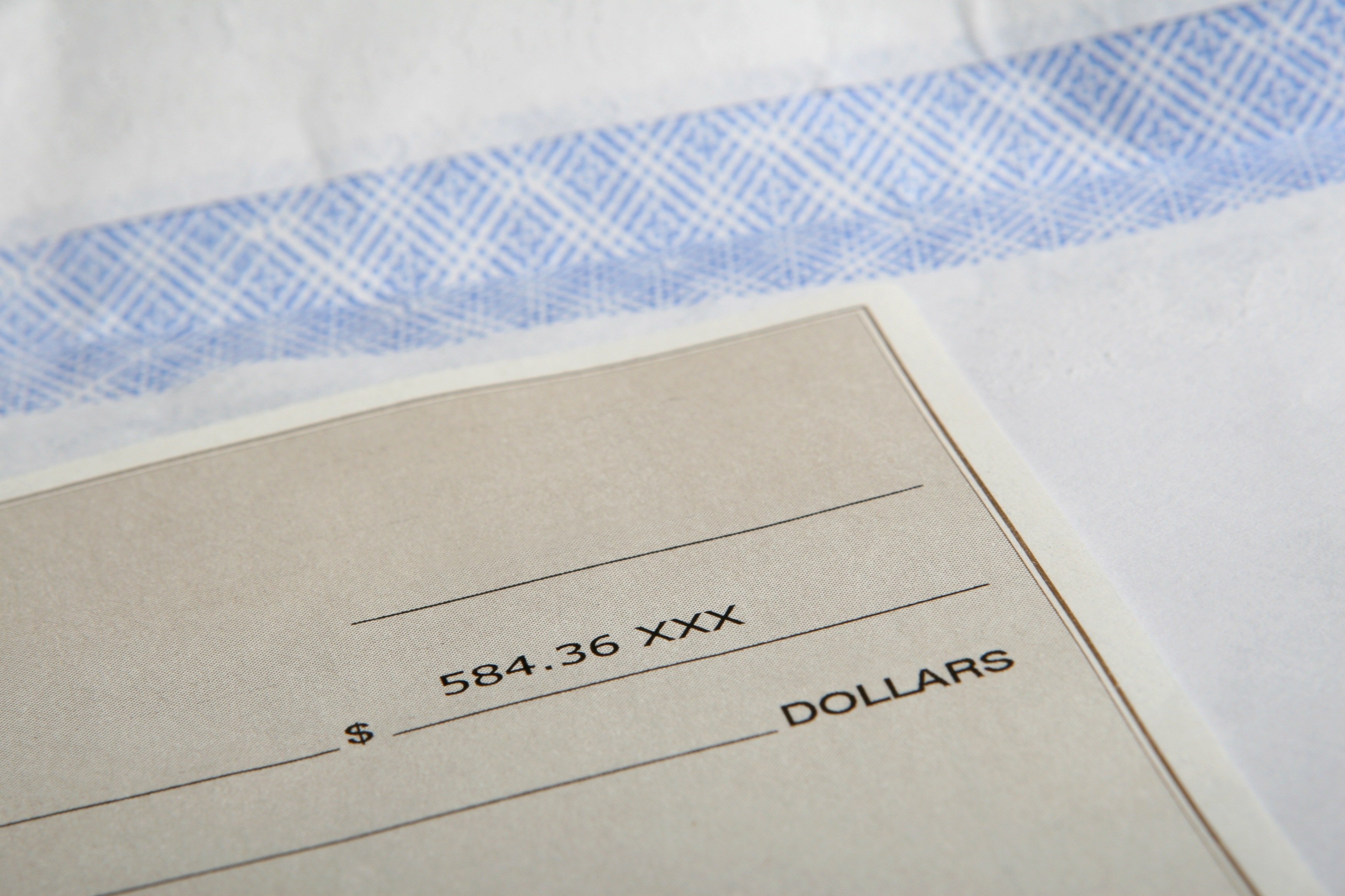 Paycheck; time to check your W-4 forms; Photo by Pixabay