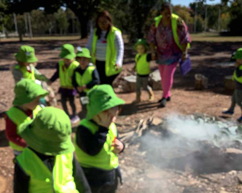 Children join a Aboriginal smoking ceremony. NAIDOC Week is important for its learning opportunities.
