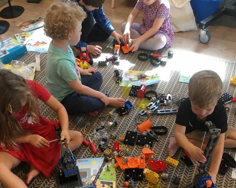 Children play indoors with toys. Controlling and assessing risks occur regularly in studios and outdoor areas.