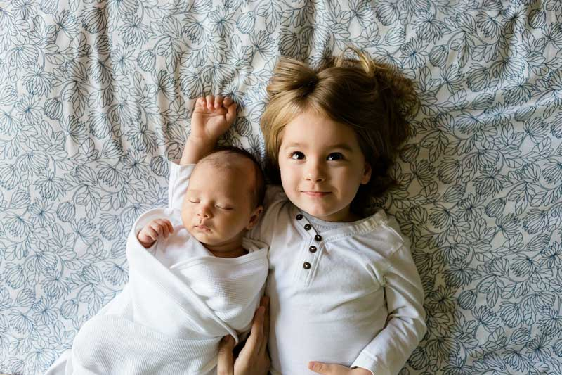 Newborn and older sibling sharing experiences helps to prevent sibling jealousy.