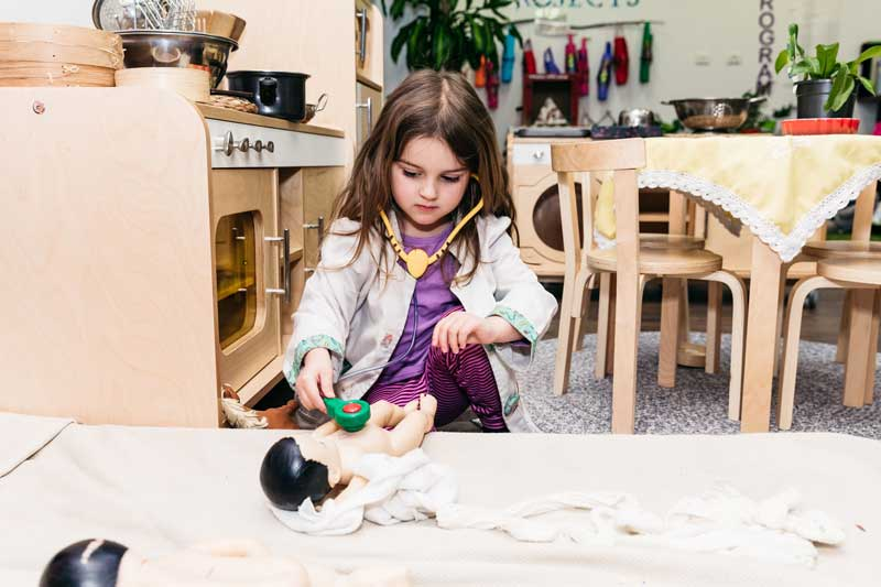 Child dresses up as a doctor. Cleaning games can include roleplay and dressup.