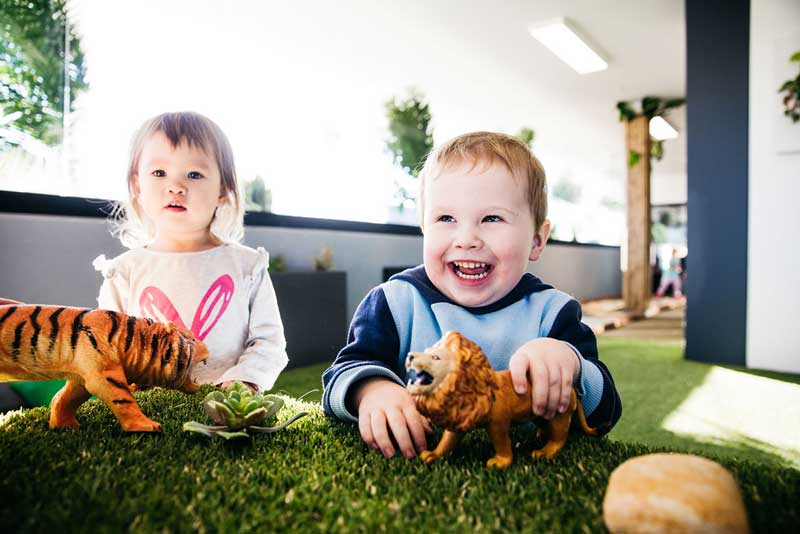 Children playing at daycare while mum and dad re-enter the workforce.