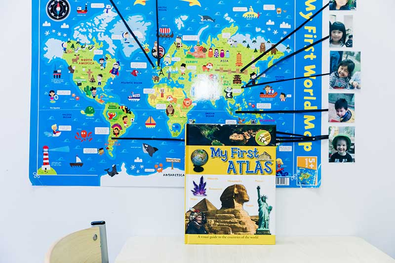 World map showing children's backgrounds to promote multicultural diversity.