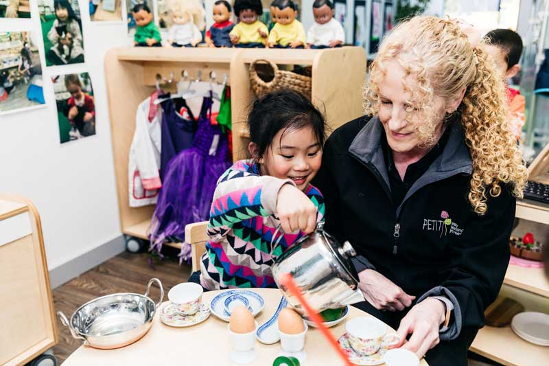 A child's rainy day idea is to share her fancy tea party with an Educator.