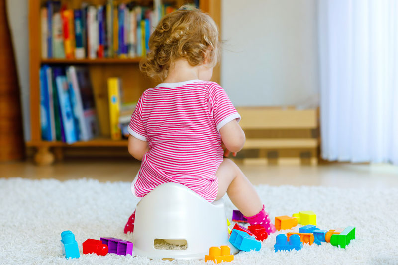 Toilet training tip: Child practises sitting on a potty for potty training