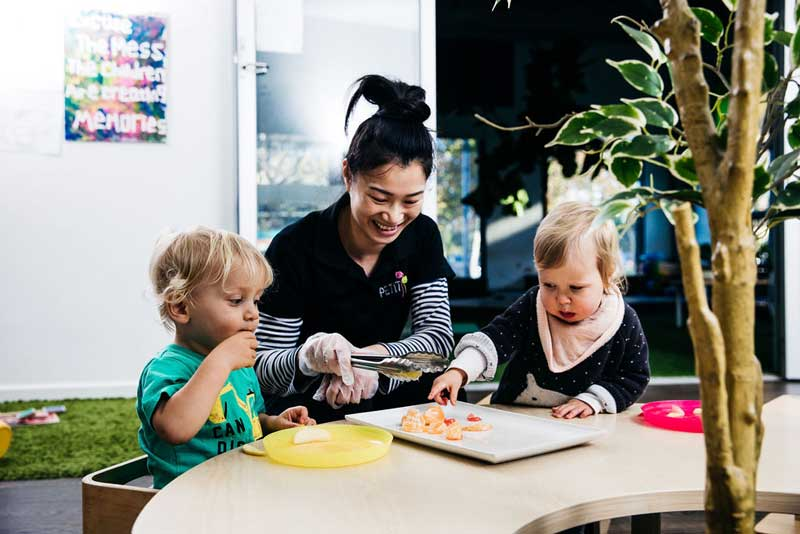 An Educator putting children first by giving them choices for afternoon tea.