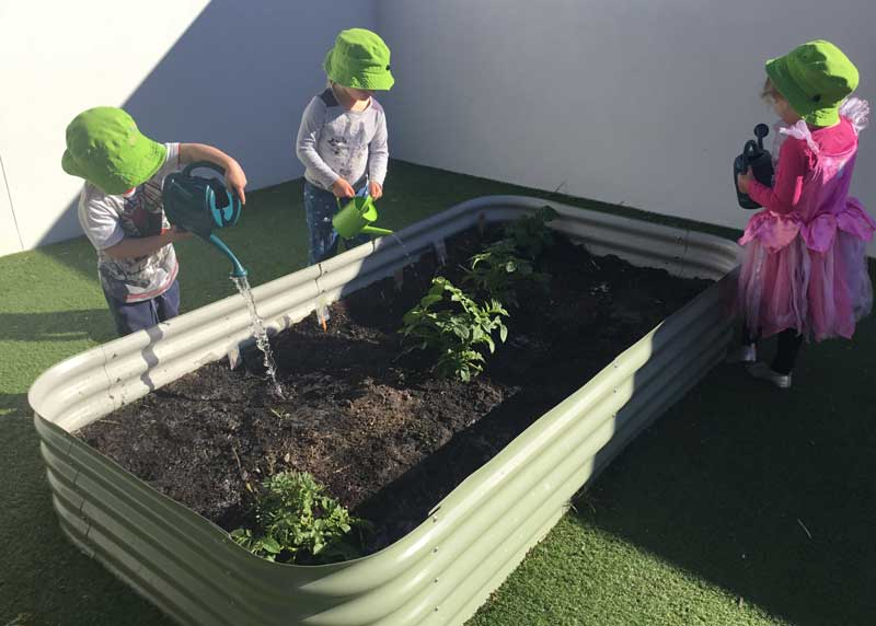 Children wearing hats to protect from the sun on Burleigh's rooftop, an area identified as commonplace for risks and hazards.